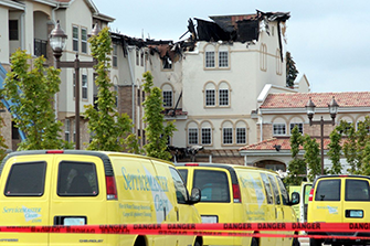 servicemaster vans in front of fire damaged building