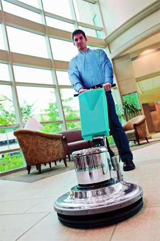 man polishing floor with servicemaster floor polisher