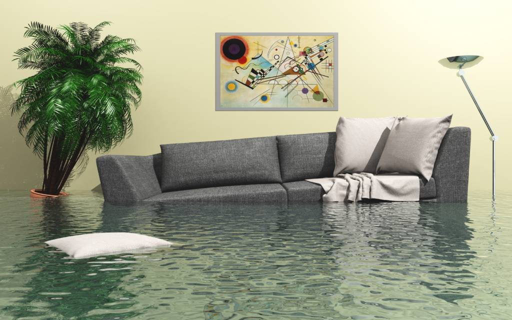 grey couch floating in a house flood