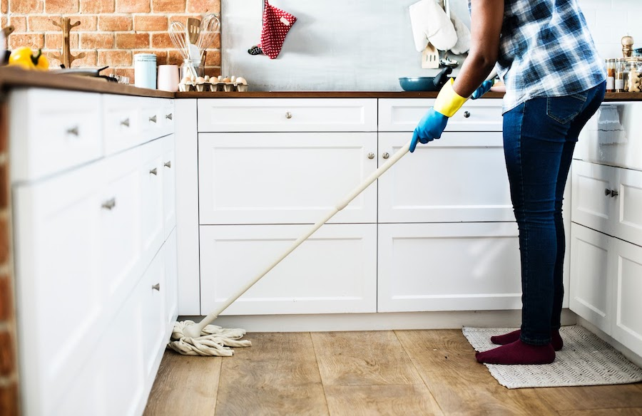 woman mopping floor in kitchen