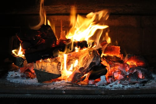 roaring fire in a fireplace
