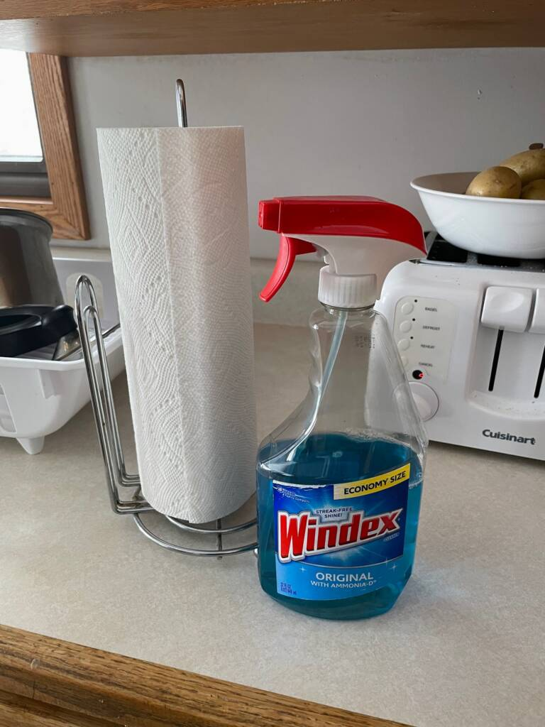 bottle of Windex and paper towels